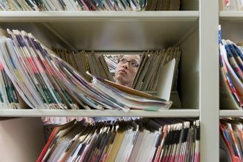 Peering-thru-medical-records-350.jpg